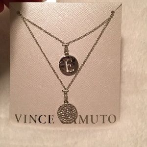 NWT Vince Camuto necklace with initial 'E'.